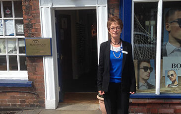 Malcolm Gray staff member, stood outside Eccleshall store